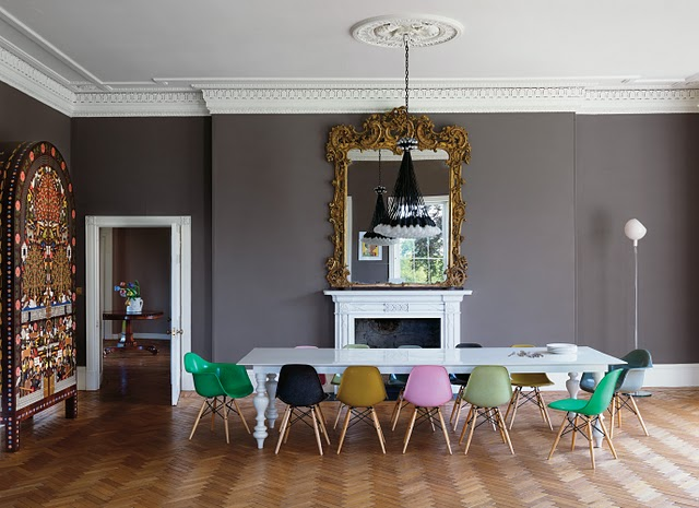 colored chairs in dining room