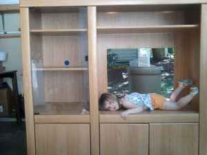 kid in cabinet