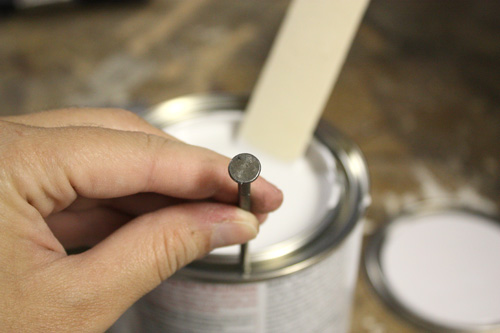 nail in can